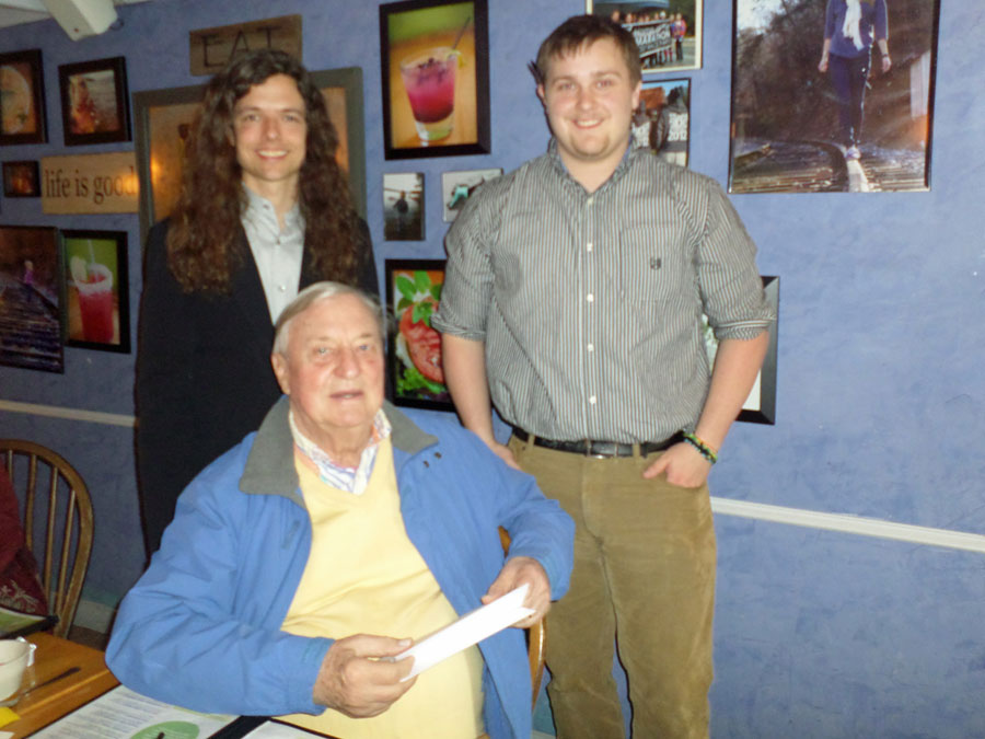 Scholarship winners Peter Kennell, Ezra Hallett and Helmut Weber who is shown seated. PHOTOGRAPH COURTESY OF THE BAR HARBOR GARDEN CLUB.